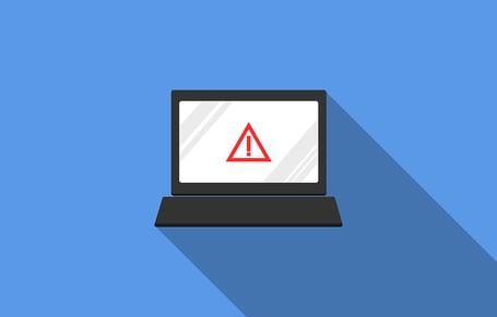 Computer displaying a warning